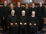 Court affirms dismissal of First Amendment case; splits over remand