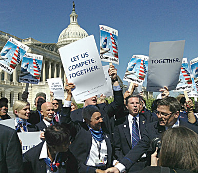 American and US Airways employees rallied outside the White House in September, hoping to push the DOJ to settle its lawsuit. Photo courtesy of The Dallas Morning News